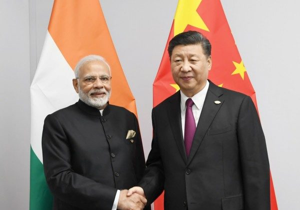 Modi meeting the President of the People's Republic of China, Mr. Xi Jinping